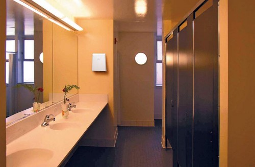 Washroom with hot air hand dryer